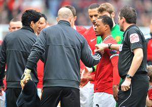 Suarez (left) refused to shake Evra's hand before a match in 2012 (Martin Rickett/PA)