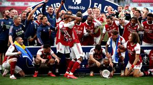 Arsenal players react after Pierre-Emerick Aubameyang (centre left) drops the trophy after the Heads Up FA Cup final match at Wembley Stadium, London.
