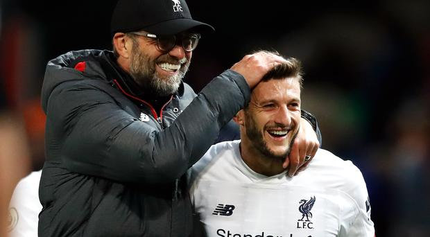 Liverpool manager Jurgen Klopp (left) celebrates with Adam Lallana after the Premier League draw at Old Trafford (Martin Rickett/PA)