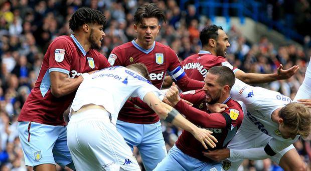 Leeds and Villa players are involved in a fracas after the home side's controversial opener (Clint Hughes/PA)