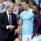 Roy Hodgson (left) is convinced there is more to come from John Stones (centre) (Nick Potts/PA)