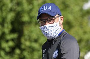 Schalke head coach David Wagner – the former Huddersfield manager – leaves the hotel where his team stay in quarantine (Martin Meissner/AP)