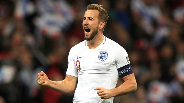 Harry Kane celebrates scoring his third goal and England's fifth (Mike Egerton/PA)