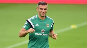 Northern Ireland's Aaron Hughes has suffered an ankle injury