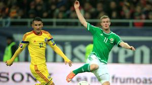 Northern Ireland have been granted permission to travel to Bucharest to face Romania