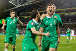 Late late show: Shane Long is mobbed after scoring the Republic's late equaliser against Poland at the Aviva