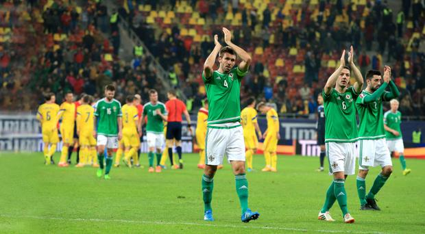 Support: Gareth McAuley and Chris Baird applaud the visiting fans on Friday night