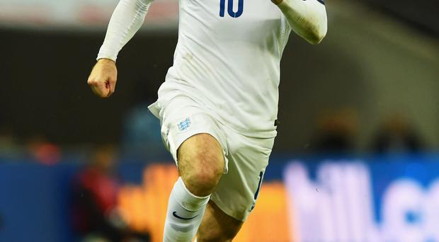Ton up: Wayne Rooney scored the equaliser for England against Slovenia after being presented with his 100th international cap