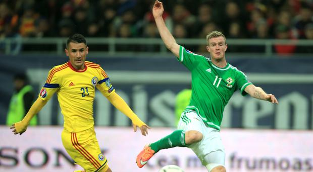 So close: Chris Brunt can only watch as his shot runs agonisingly wide of the goal with the score at 0-0 in Bucharest
