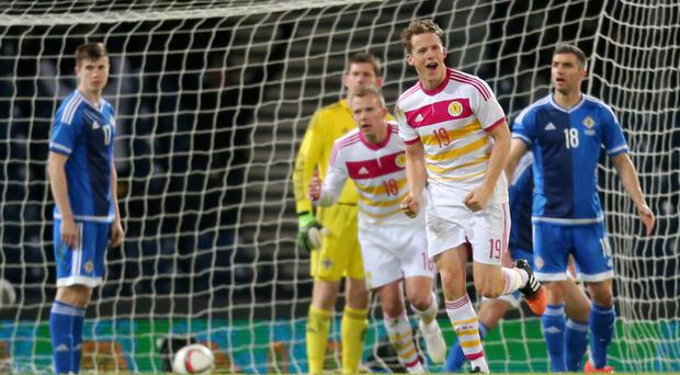 Decisive goal: Christophe Berra celebrates Scotland's winner at Hampden Park