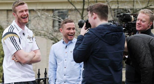 All smiles: Chris Brunt and boxer Carl Frampton have a laugh as the latter interviews the NI star for BBC's Football Focus