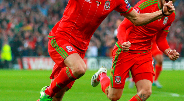 You beauty: Wales' Gareth Bale celebrates after scoring his side's winner against Belgium