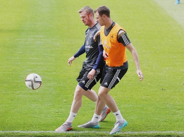 Double act: Jonny Evans and Chris Brunt are in the NI squad despite the former's lack of game time and the latter's injury