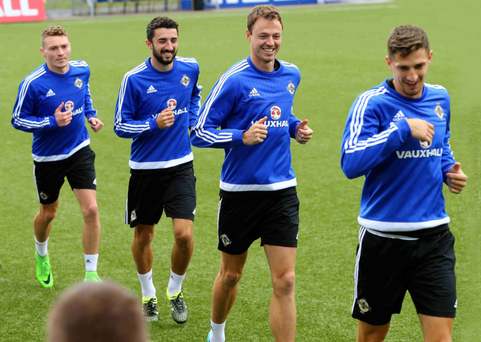 Let's go: Craig Cathcart leads Jonny Evans, Conor McLaughlin and Caolan Lavery during training