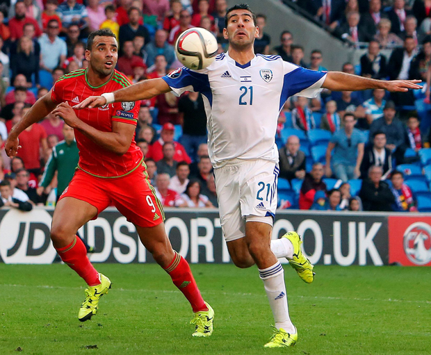 Controversial decision: Eitan Tibi (right) appears to handle the ball as Wales's midfielder Hal Robson-Kanu looks on