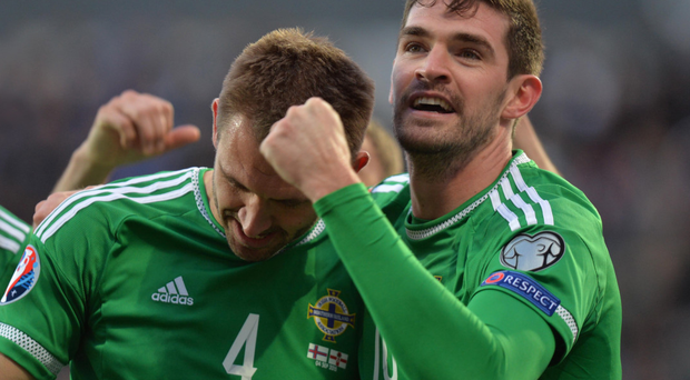 Better days: Kyle Lafferty celebrates with fellow goalscorer Gareth McAuley during the win over the Faroe Islands