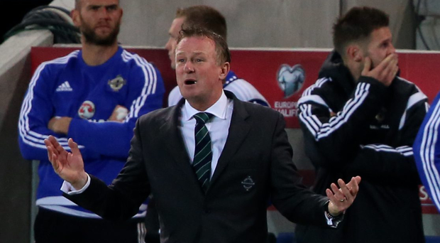Shouting the odds: Michael O'Neill wants the feelgood factor to roll into the World Cup qualifiers