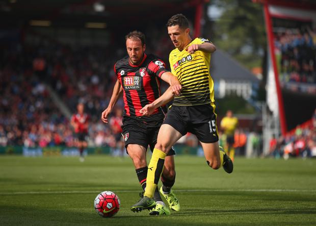 Ready for action: Watford defender Craig Cathcart, seen here getting the better of Bournemouth's Glenn Murray on Saturday, is in line to start for Northern Ireland against Greece