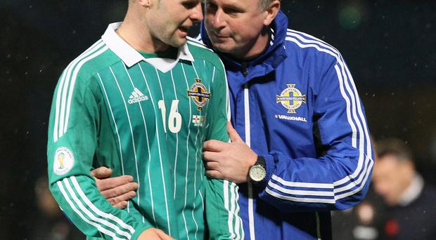 Respect: Oliver Norwood says he hopes Michael O'Neill will remain Northern Ireland boss for a long time