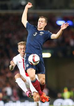 Poland's Kamil Grosicki (left) and Scotland's Steven Whittaker