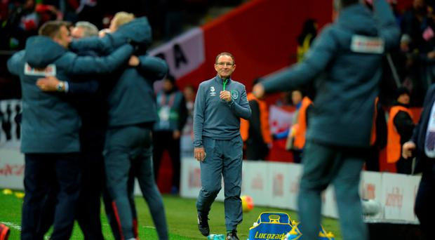 Feeling down: Martin O'Neill looks on as Poland celebrate automatic qualification to Euro 2016