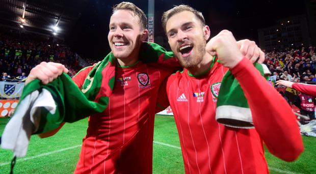 We're through: Chris Gunter and Aaron Ramsey of Wales