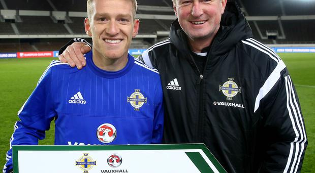 Manager Michael O'Neill with skipper Steven Davis