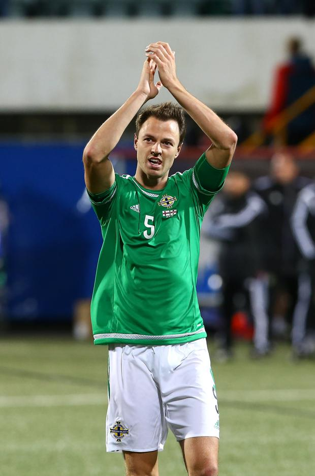 Defensive strength: Jonny Evans knows he faces competition in the centre of Northern Ireland's defence ahead of Euro 2016