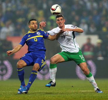Stalemate: Vedad Ibisevic of Bosnia challenges for the ball with the Republic's Ciaran Clark