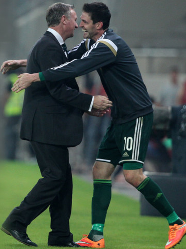 Moment to savour: Michael O'Neill celebrates with Kyle Lafferty after victory in Greece