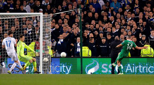 Sweet strike: Jonathan Walters fires the Republic of Ireland's second goal against Bosnia to seal Euro 2016 qualification