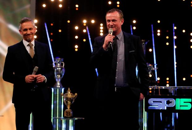 On the mic: Michael O'Neill takes his time to thank everyone at the SPOTY awards as an anxious Gary Lineker looks on