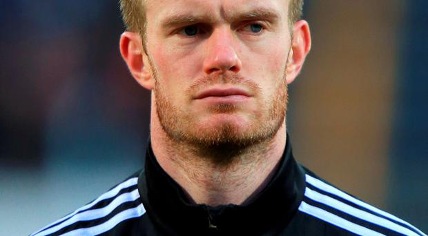 A teenager arrested following an incident in which West Brom's Chris Brunt was struck in the face by a coin has been cautioned