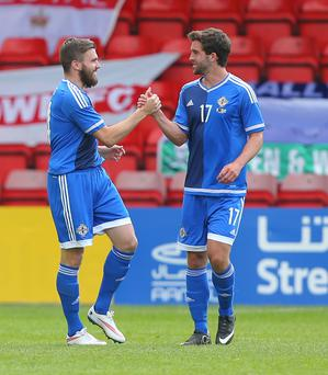 On fire: Will Grigg (right) hails Stuart Dallas' goal against Qatar and is hoping to impress boss Michael O'Neill