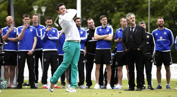 Big hitter: NI stars and presenter David Feherty watch Rory McIlroy in action