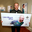 Star billing: Liam Boyce shows off his billboard, which is on display in Belfast