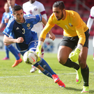 In the running: Daniel Lafferty, pictured during the friendly with Qatar last year, is determined to book his place on Northern Ireland's plane to France