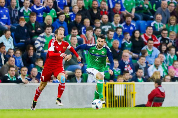 Amazing journey: Conor McLaughlin, pictured taking on Belarus at Windsor Park, admits the last two years have been crazy after making his Northern Ireland debut and qualifying for the Euro 2016 finals