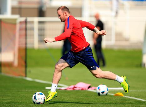 In at the deep end: Wayne Rooney will be playing in a deep lying midfield position for England for the first time in their opening clash against Russia