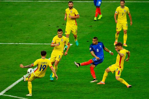 Killer touch: West Ham ace Dimitri Payet hammers home France's second goal in their 2-1 victory over Romania last night