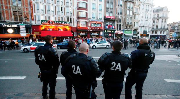 French riot police look on as England fans sing in Lille city centre, as England and Wales fans appear to have been caught up in violent clashes with Russian fans in video footage posted on social media. PRESS ASSOCIATION Photo. Picture date: Tuesday June 14, 2016. Mobile phone video posted on Twitter showed two sets of fans facing off outside a bar, with chairs strewn across the pavement on the Place de la Gare, in central Lille. See PA story SPORT Euro2016. Photo credit should read: Niall Carson/PA Wire