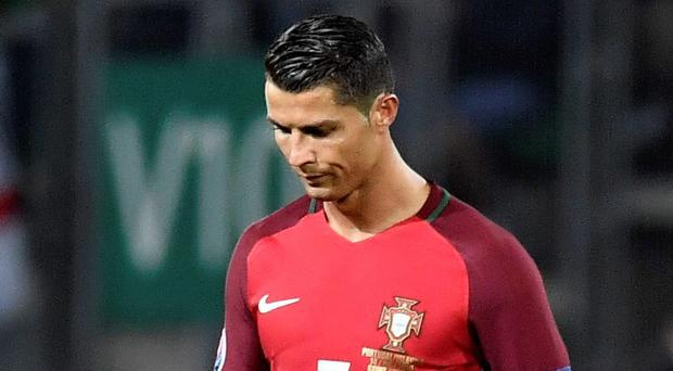 Cristiano Ronaldo shows his disappointment at the end of the game