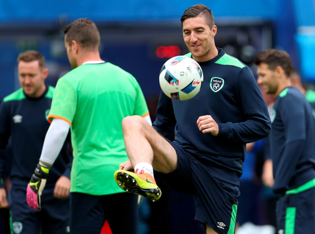 Gearing up: Republic of Ireland's Stephen Ward warms up for the Belgium battle