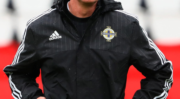 Alongside the best: Michael O'Neill is delighted to challenge himself against a World Cup winning manager