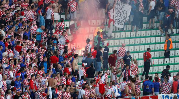 In trouble: Croatia fans threw fireworks in their game in St Etienne