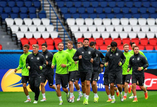 Champion run-out: The Germany squad at their final training session before this evening's game in the Parc des Princes