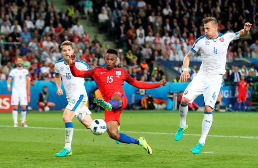No way through: England's Daniel Sturridge (centre) misses a chance on goal