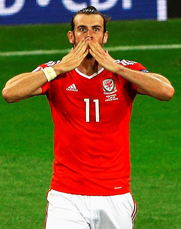 Hot stuff: Gareth Bale celebrates his third goal in as many matches to seal Wales' decisive victory over Russia