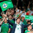 We're not going home: Northern Ireland fans enjoy the atmosphere at the Parc des Princes and they could be back there on Saturday
