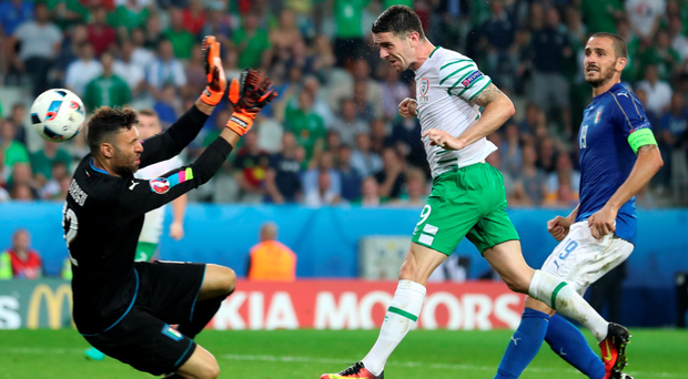 Heads I win: Robbie Brady scores the Republic of Ireland's winner against Italy in Lille last night to propel Ulsterman Martin O'Neill's side into a last-16 clash with Euro 2016 hosts France